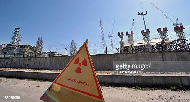 Photo taken on April 23 2013 shows the sections of a colossal archshaped structure that will cover the exploded reactor at the Chernobyl nuclear...