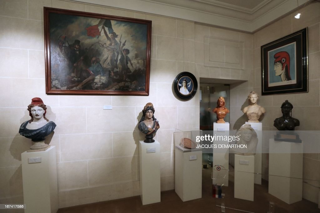 A photo taken on April 25, 2013 at the French Senate, upper house of France's Parliament, in the Luxembourg Palace in Paris, shows sculptures and paintings representing Marianne, a national emblem of the French Republic.
