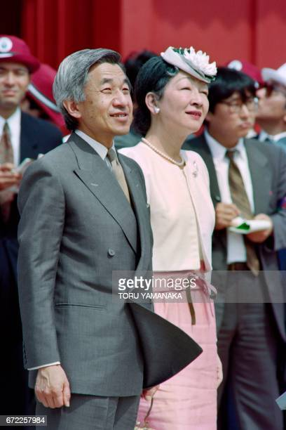 Photo taken on April 26 1993 shows Japanese Empress Michiko and Emperor Akihito during the royal couple's visit of the Shuri Castle home to the kings...