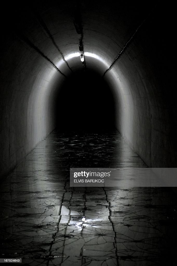 A photo taken on April 26, 2013 shows an empty corridors in the 'D-0' art museum before the opening ceremony of Second Art Biennale in the Bosnian town of Konjic. The art museum is placed inside of a former strategic nuclear shelter built by the Communist regime, 180 meters underground. Construction of the 'D-0' shelter was completed as the cold war era was coming to end and was never used by the military. It was maintained by the former Yugoslav Army until the war broke out in Bosnia in 1992. During the war, most of the equipment was preserved by the Bosnian Army until 2011, when the communist era relic was turned into an art museum.