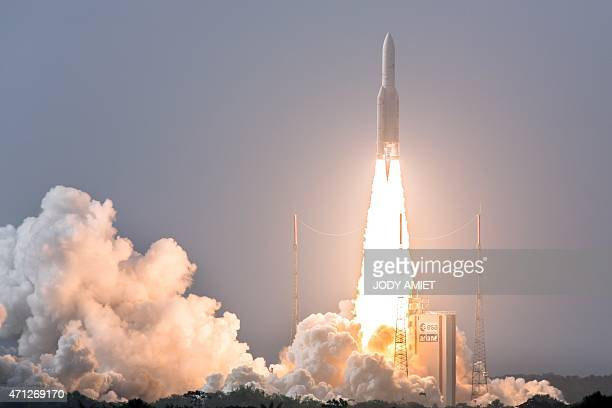 A photo taken on April 26 2015 shows an Ariane 5 rocket lifting off from its launchpad in Kourou French Guiana carrying a THOR 7 commercial satellite...