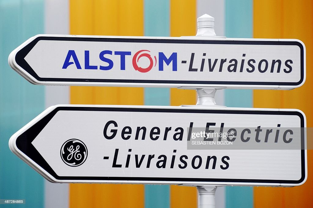 A photo taken on April 29, 2014 in Belfort shows road signs indicating directions for deliveries to French power and transport engineering company Alstom and US conglomerate General Electric (GE). The battle for Alstom was set to intensify Tuesday, with Siemens ready to confirm its bid for the French engineering group also coveted by US rival General Electric, an informed source said. French President Francois Hollande vowed on April 28, 2014 to safeguard jobs at Alstom as he met with both GE and Siemens chiefs, while Germany sought to boost Siemens' case, saying a tie-up offered a 'big opportunity' for Europe's two largest economies.