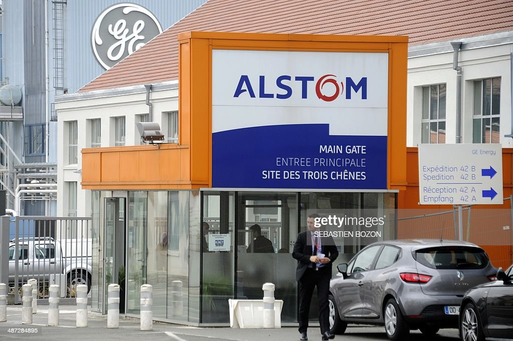 A photo taken on April 29, 2014 in Belfort shows the logos of the French power and transport engineering company Alstom and the US conglomerate General Electric (GE). The battle for Alstom was set to intensify Tuesday, with Siemens ready to confirm its bid for the French engineering group also coveted by US rival General Electric, an informed source said. French President Francois Hollande vowed on April 28, 2014 to safeguard jobs at Alstom as he met with both GE and Siemens chiefs, while Germany sought to boost Siemens' case, saying a tie-up offered a 'big opportunity' for Europe's two largest economies.