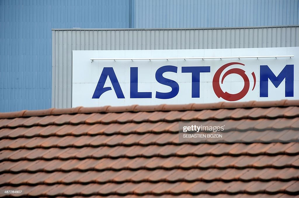 A photo taken on April 29, 2014 in Belfort shows the logos of the French power and transport engineering company Alstom. The battle for Alstom was set to intensify Tuesday, with Siemens ready to confirm its bid for the French engineering group also coveted by US rival General Electric, an informed source said. French President Francois Hollande vowed on April 28, 2014 to safeguard jobs at Alstom as he met with both GE and Siemens chiefs, while Germany sought to boost Siemens' case, saying a tie-up offered a 'big opportunity' for Europe's two largest economies.
