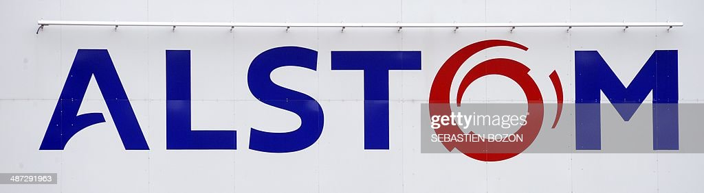 A photo taken on April 29, 2014 in Belfort shows the logos of the French power and transport engineering company Alstom. The battle for Alstom was set to intensify on April 29, with Siemens ready to confirm its bid for the French engineering group also coveted by US rival General Electric, an informed source said. French President Francois Hollande vowed on April 28, 2014 to safeguard jobs at Alstom as he met with both GE and Siemens chiefs, while Germany sought to boost Siemens' case, saying a tie-up offered a 'big opportunity' for Europe's two largest economies. AFP PHOTO / SEBASTIEN BOZON