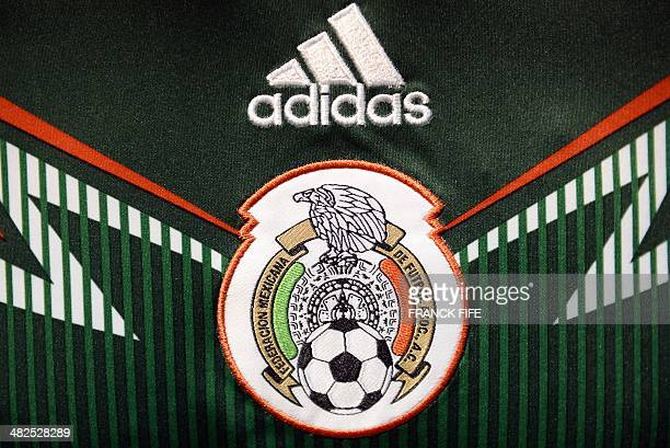 A photo taken on April 3 2014 in Paris shows a partial view of the new jersey of Mexico's national football team AFP PHOTO / FRANCK FIFE