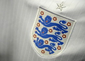 A photo taken on April 3 2014 in Paris shows a partial view of the new jersey of England's national football team AFP PHOTO / FRANCK FIFE