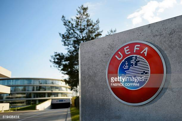 A photo taken on April 6 2016 shows the logo of European football body UEFA at the UEFA headquarters in Nyon Swiss police raided the headquarters of...