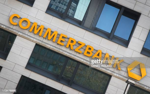 A photo taken on April 7 2011 shows the logo of the German bank Commerzbank on a branch of the bank in Frankfurt Main western Germany Commerzbank...