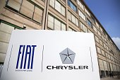 A photo taken on August 1 2014 shows a banner of Fiat Chrysler in front of Fiat Headquarters at Lingotto in Turin Fiat which took full control of...