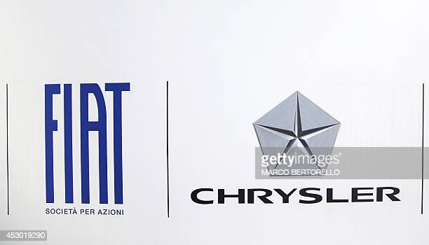 A photo taken on August 1 2014 shows the logo of Fiat Chrysler in front of Fiat Headquarters at Lingotto in Turin Shareholders in Italian carmaker...