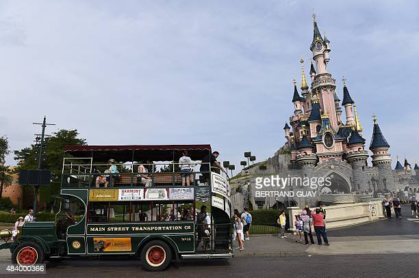 A photo taken on August 13 2015 shows the Sleeping Beauty Castle at Disneyland Paris in MarnelaVallee east of Paris AFP PHOTO / BERTRAND GUAY