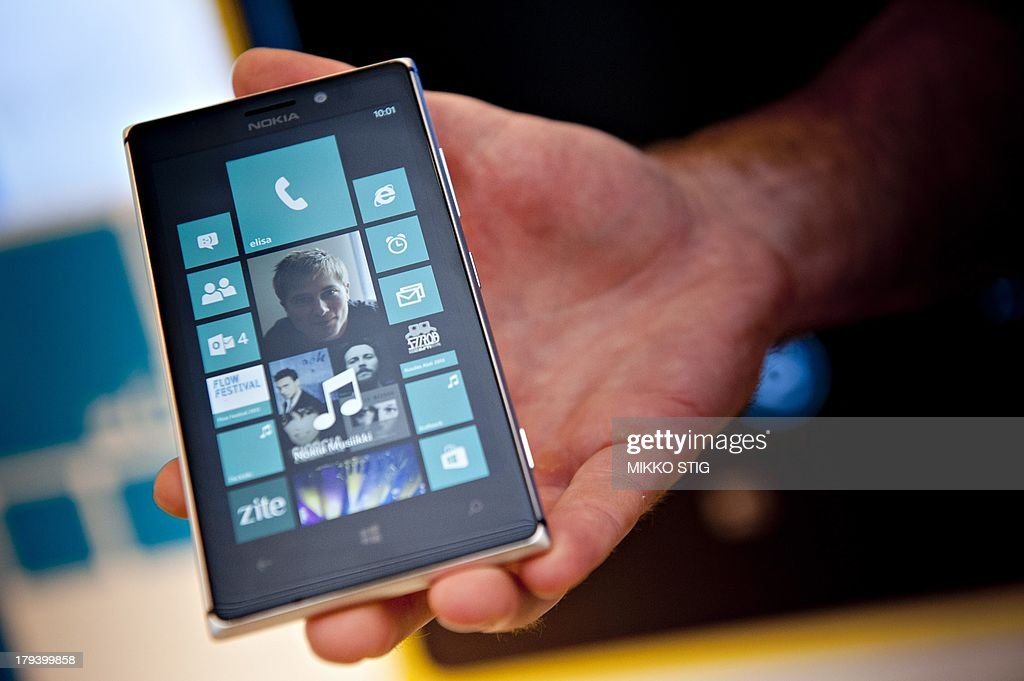 A photo taken on August 15 2013 shows a Nokia Lumia 925 mobile telephone at the flagship store of Finnish mobile phone manufacturer Nokia in Helsinki...