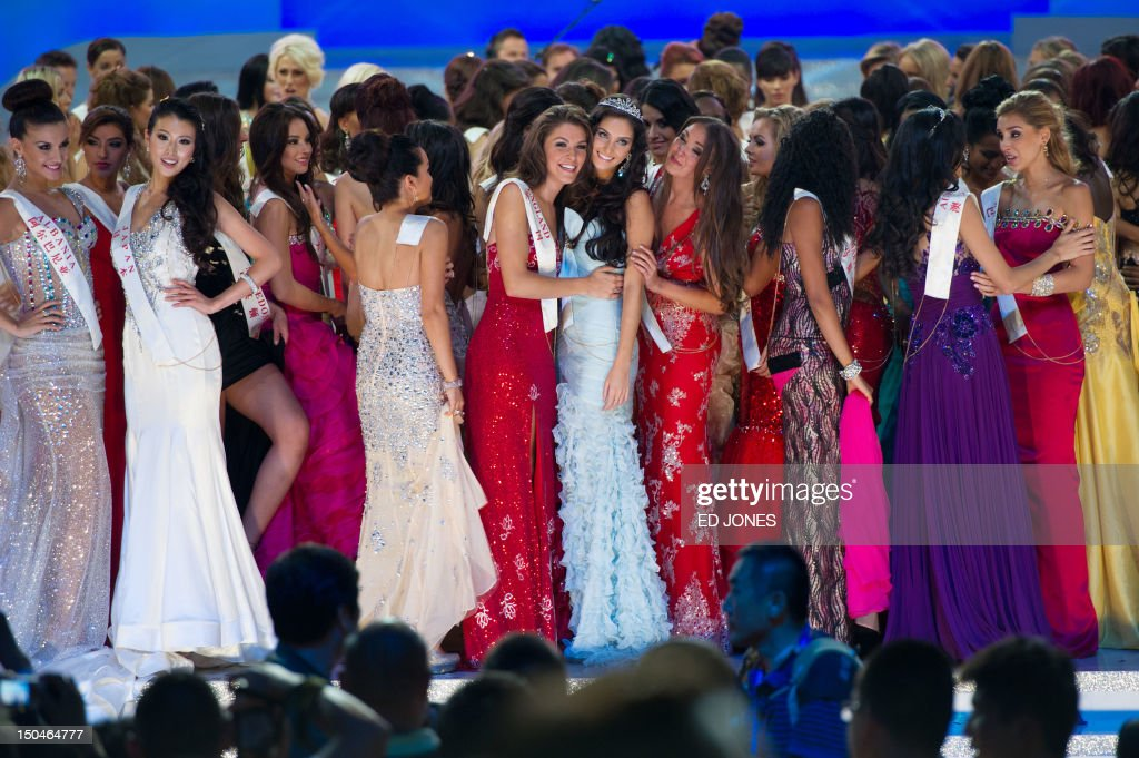 A photo taken on August 18, 2012 shows Miss England Charlotte Holmes (centre L) and Miss Wales Sophie Moulds (centre R) as they celebrate following the Miss World 2012 final ceremony at the Dongsheng stadium in the inner Mongolian city of Ordos . China's Yu Wenxia of China defeated more than 100 other hopefuls at the glittering ceremony held in the Chinese mining city of Ordos, on the edge of the Gobi desert. AFP PHOTO / Ed Jones