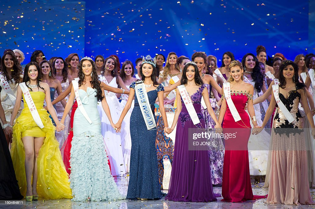 A photo taken on August 18, 2012 shows (front L-R) Miss Thailand Vanessa Herrmann, second place Miss Wales Sophie Moulds, winner Miss China Yu Wenxia, Miss Australia Jessica Kahawaty, Miss Brazil Mariana Notarangelo, and Miss India Vanya Mishra as they celebrate following the Miss World 2012 final ceremony at the Dongsheng stadium in the inner Mongolian city of Ordos. China's Yu Wenxia of China defeated more than 100 other hopefuls at the glittering ceremony held in the Chinese mining city of Ordos, on the edge of the Gobi desert. AFP PHOTO / Ed Jones