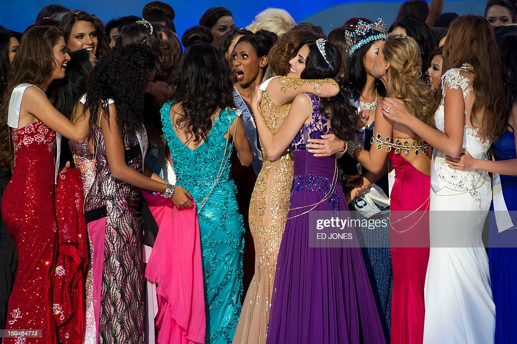 A photo taken on August 18, 2012 shows Miss World 2012 contestants as they celebrate following the pageant's final ceremony at the Dongsheng stadium in the inner Mongolian city of Ordos. China's Yu Wenxia of China defeated more than 100 other hopefuls at the glittering ceremony held in the Chinese mining city of Ordos, on the edge of the Gobi desert. AFP PHOTO / Ed Jones