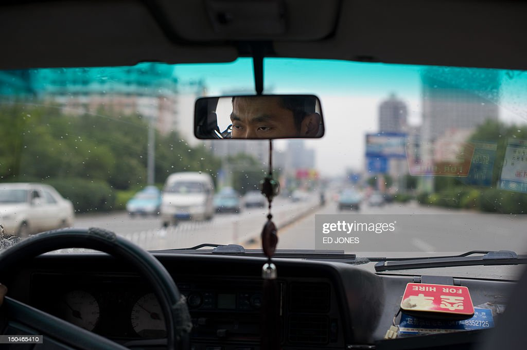 A photo taken on August 18, 2012 shows the view from a taxi in the inner Mongolian city of Ordos. Miss China won the coveted title of Miss World on August 18, triumphing on home soil during a glitzy final held in a mining city on the edge of the Gobi desert. The city has grown rich over the past decade on the back of a coal mining boom that has transformed it from a sandstorm-afflicted backwater into one of the wealthiest places in China. The boom triggered a frenzy of building in the city, but the local government has struggled to fill the vast tower blocks that sprung up, earning it the title of China's biggest ghost town. AFP PHOTO / Ed Jones