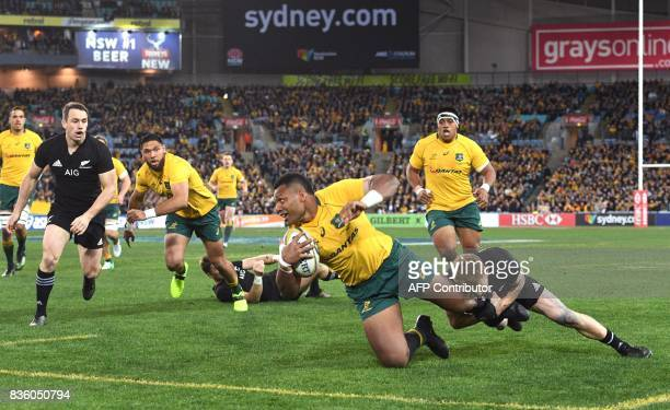 A photo taken on August 19 2017 shows Australia's centre Samu Kerevi being tackled by New Zealand's fullback Damian McKenzie during the Rugby...