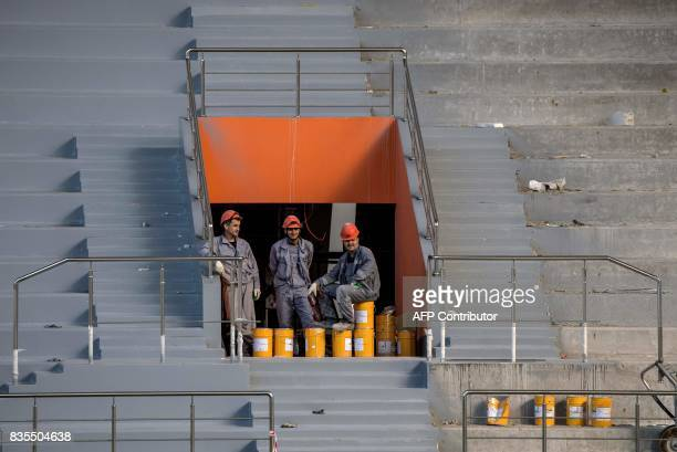 A photo taken on August 19 2017 shows workmen in the stands during the renovation to the Yekaterinburg Arena in Yekaterinburg Yekaterinburg Arena...