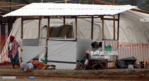 A photo taken on August 21 2014 shows victims of Ebola sitting and laying on the floor at the Medecins Sans Frontieres/Doctors without Borders ELWA...