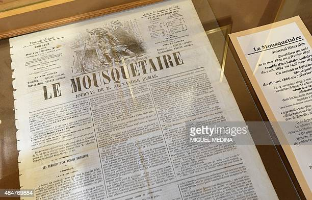 A photo taken on August 21 2015 shows a copy of the literary journal 'Le Mousquetaire' on display at the Chateau de MonteCristo in Le PortMarly...
