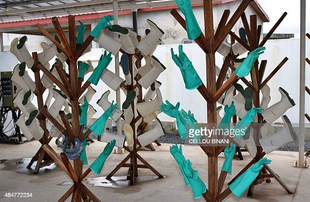 A photo taken on August 21 2015 shows disinfected gloves and boots at the Nongo ebola treatment centre in Conakry Guinea The World Health...