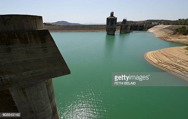 A photo taken on August 21 2016 shows the Sidi Salem dam near Testour in Tunisia's northwest Beja region which has particularly low water levels due...