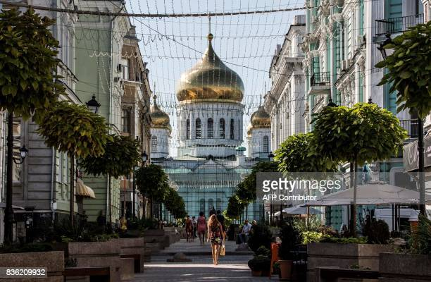 A photo taken on August 21 2017 shows a pedestrian street with the Assumption Cathedral at the background in the centre of the southern Russian city...