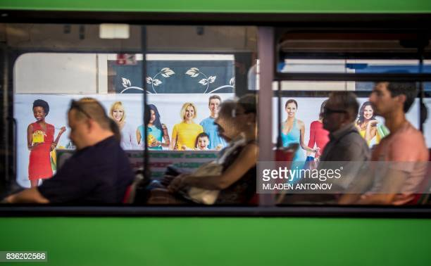 A photo taken on August 21 2017 shows commuters in a bus in the southern Russian city of RostovonDon RostovonDon will host five games of the FIFA...
