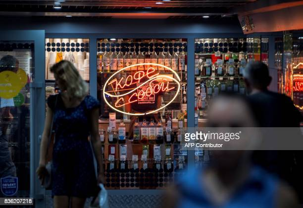 A photo taken on August 21 2017 shows people walking in an underground passage with a shop offering takeaway coffee in the centre of the southern...
