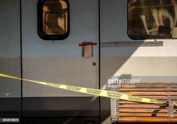 A photo taken on August 22 2015 shows police tape cordonning off a sealed Thalys train of French national railway operator SNCF at the main train...