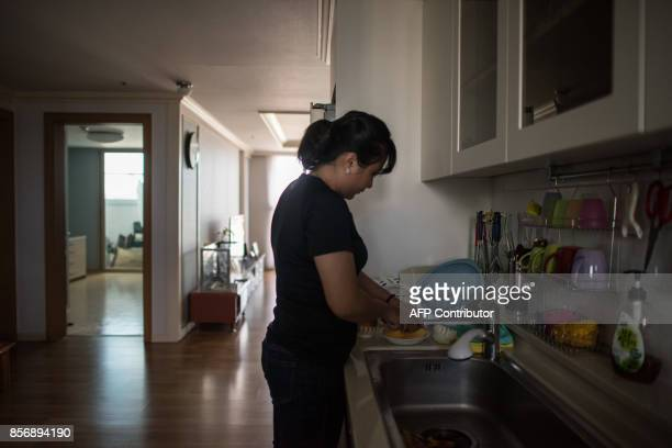 A photo taken on August 23 2017 shows Huynh Thi Thai Muoi of Vietnam in the apartment she shares with husband Kim KyeongBok in Gwangju There are some...