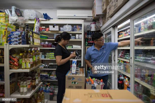 A photo taken on August 23 2017 shows Huynh Thi Thai Muoi of Vietnam and husband Kim KyeongBok of South Korea shopping for groceries at a convenience...