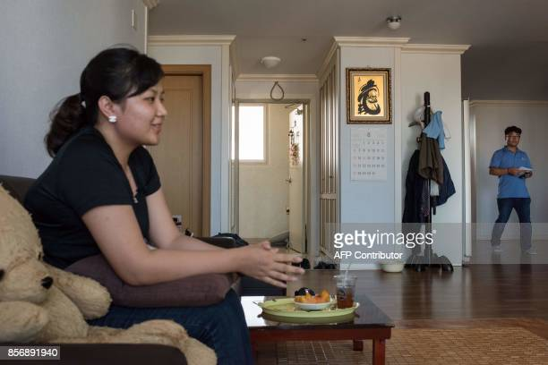 A photo taken on August 23 2017 shows Huynh Thi Thai Muoi of Vietnam and husband Kim KyeongBok of South Korea in their apartment in Gwangju There are...