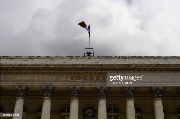 A photo taken on August 24 2015 shows a French flag and the word 'Bourse' on the pediment of the Palais Brongniart the former French stock market The...