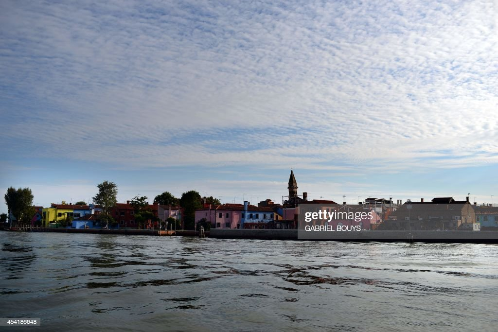 A photo taken on August 25, 2014 shows colored houses in Burano, an island in the Venetian lagoon. Burano is known for its small, brightly painted houses. The colors of the houses follow a specific system originating from the golden age of its development. People wishing to paint a house must send a request to the government, which will respond by giving certain colors permitted for that lot.
