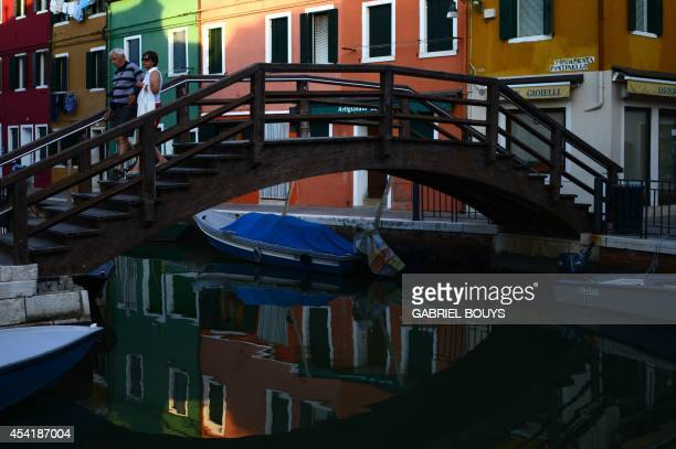 A photo taken on August 25 2014 shows colored houses in Burano an island in the Venetian lagoon Burano is known for its small brightly painted houses...