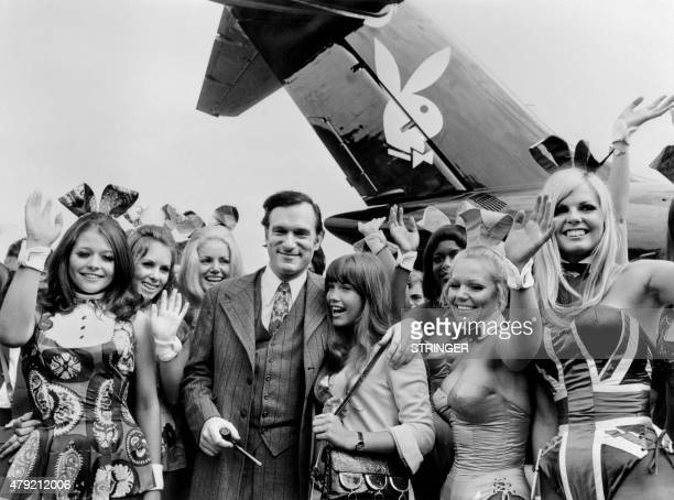 Photo taken on August 30 1970 shows US Playboy Magazine publisher Hugh Hefner his girlfriend actress Barbara Benton and other playmates arriving at...