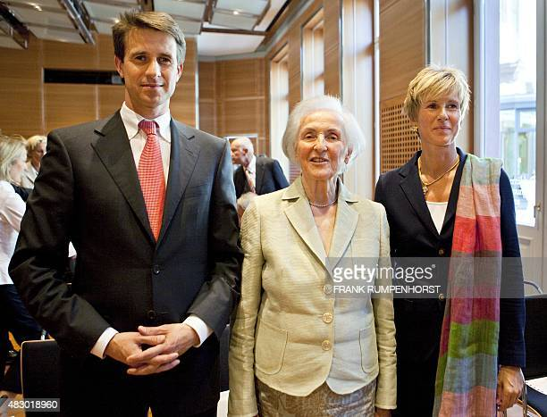 A photo taken on August 31 2009 shows major shareholder of German carmaker BMW Johanna Quandt posing with his children Stefan Quandt and Susanne...