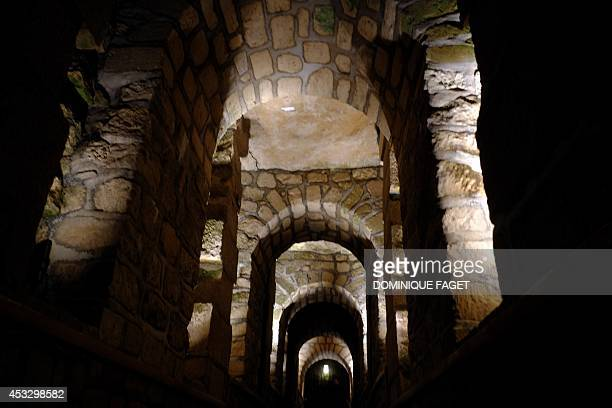 Photo taken on August 7 2014 at the Catacombs of Paris shows a view of the quarries These underground quarries were used to store the remains of...