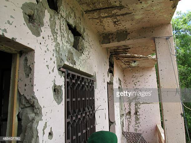A photo taken on August 8 2015 shows bullet holes in the walls of the Hotel Byblos in the central Malian town of Sevare after gunmen stormed the...