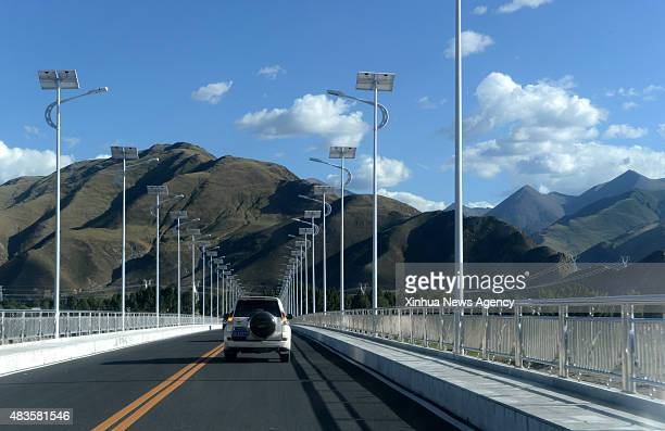 Photo taken on August 8 2015 shows the Dagze Bridge over Lhasa River southwest China's Tibet Autonomous Region People witnessed amazing progress of...