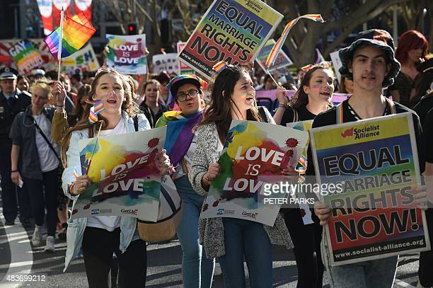 Photo taken on August 9 2015 shows supporters of samesex marriage shouting slogans as they take part a rally and march in Sydney Australian Prime...