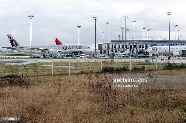 A photo taken on December 11 2014 shows the first Airbus A350 bearing the Qatar airline company logo on the tarmac of Toulouse Blagnac airport AFP...