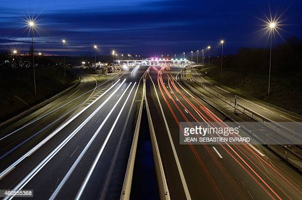A photo taken on December 16 2014 shows cars driving down a toll road in Ancenis western France The French Economy Minister announced on December 10...