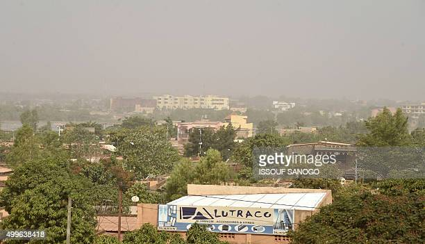A photo taken on December 2 2015 shows polluted view of Ouagadougou Burkina Faso a Sahelian country that is regularly hit by drought / AFP / ISSOUF...