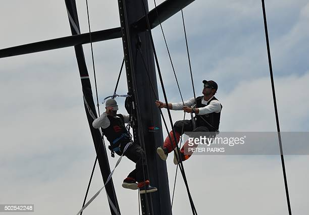 Photo taken on December 26 2015 shows crew members preparing Supermaxi yacht Comanche before the start of the Sydney to Hobart yacht race in Sydney...