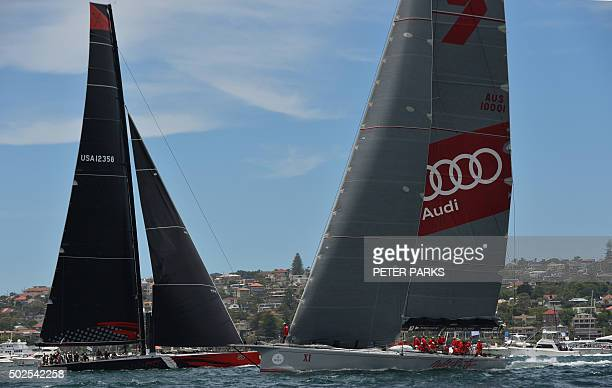 Photo taken on December 26 2015 shows Supermaxi yachts Comanche and Wild Oats XI before the start of the Sydney to Hobart yacht race in Sydney...