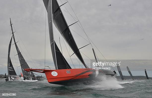 Photo taken on December 26 2015 shows Supermaxi yachts Comanche and Perpetual Loyal after the start of the Sydney to Hobart yacht race in Sydney...