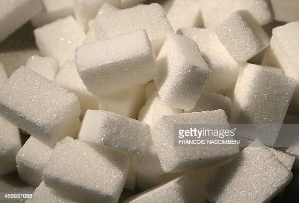 A photo taken on December 3 2014 shows sugar cubes at the Crystal Union Group refinery in Bazancourt near the eastern city of Reims The refinery one...